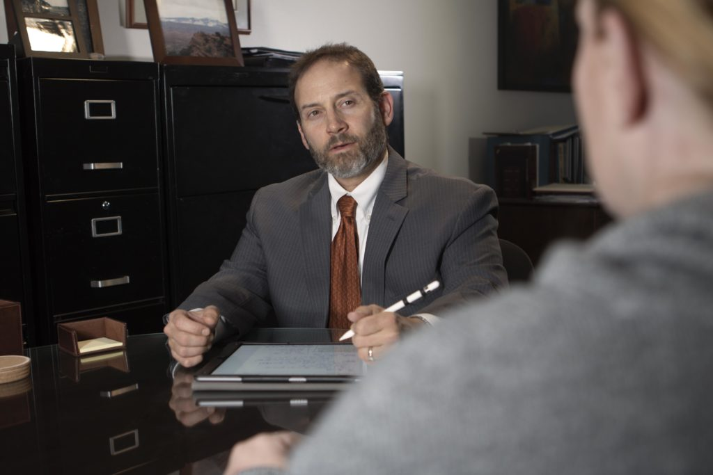 Mark Solomon, DUI Defense Lawyer, in a meeting